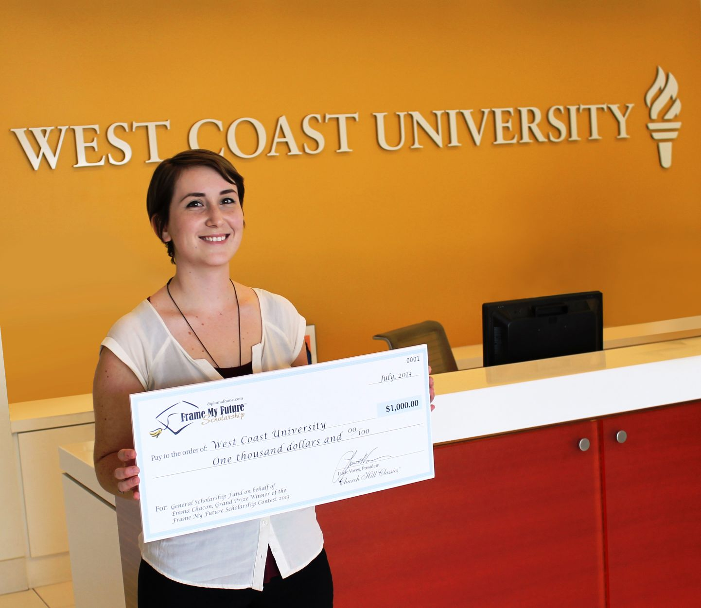 Emma Chacon - Grand Prize Winner presenting the donation check to West Coast University