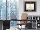 dimensions diploma frame on display in a work office