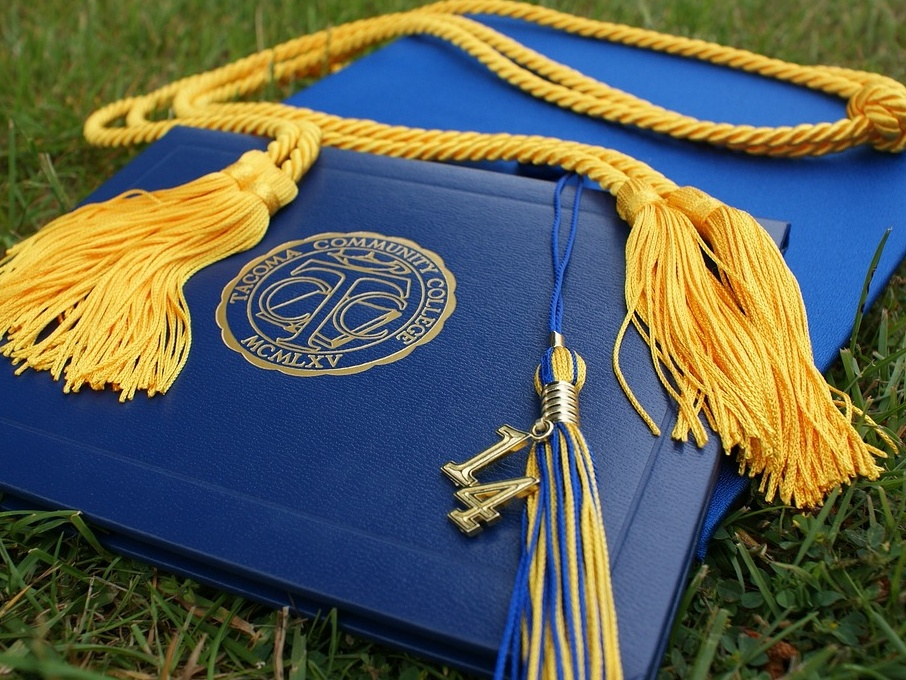 graduation cap, tassel, and diploma