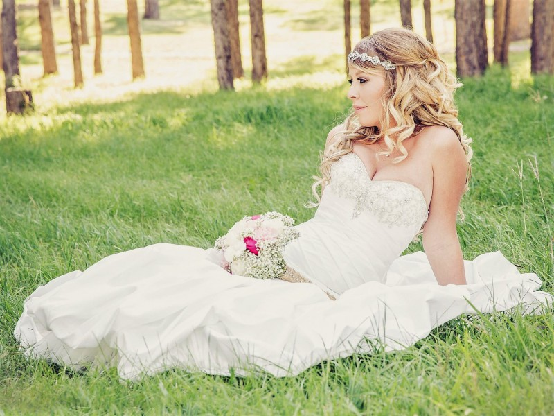 woman in wedding dress outside on grass