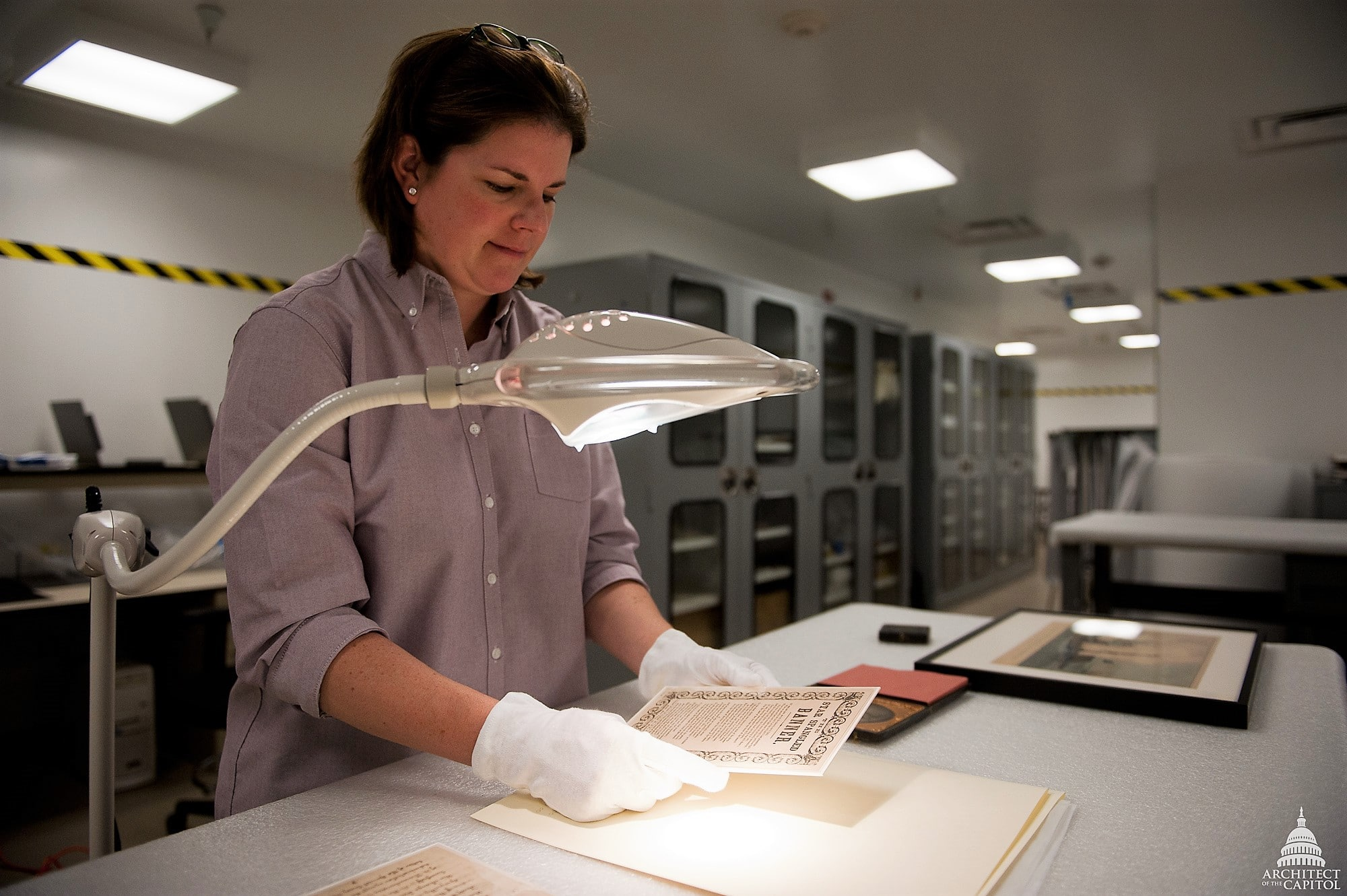 woman working on restoring documents