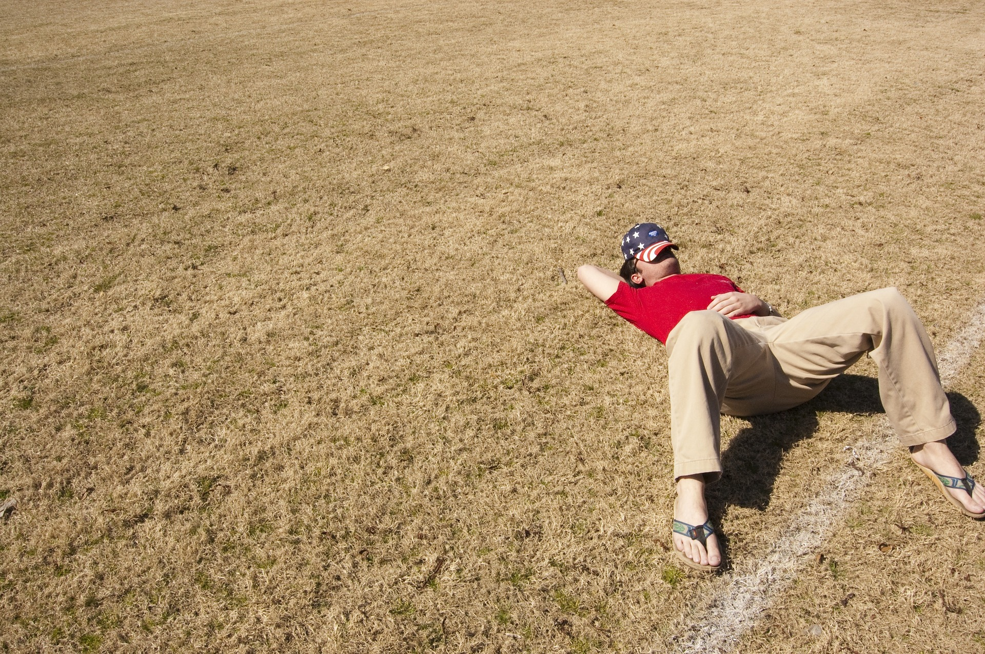 man sleeping outside on the grass