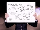 business man holding innovation white board