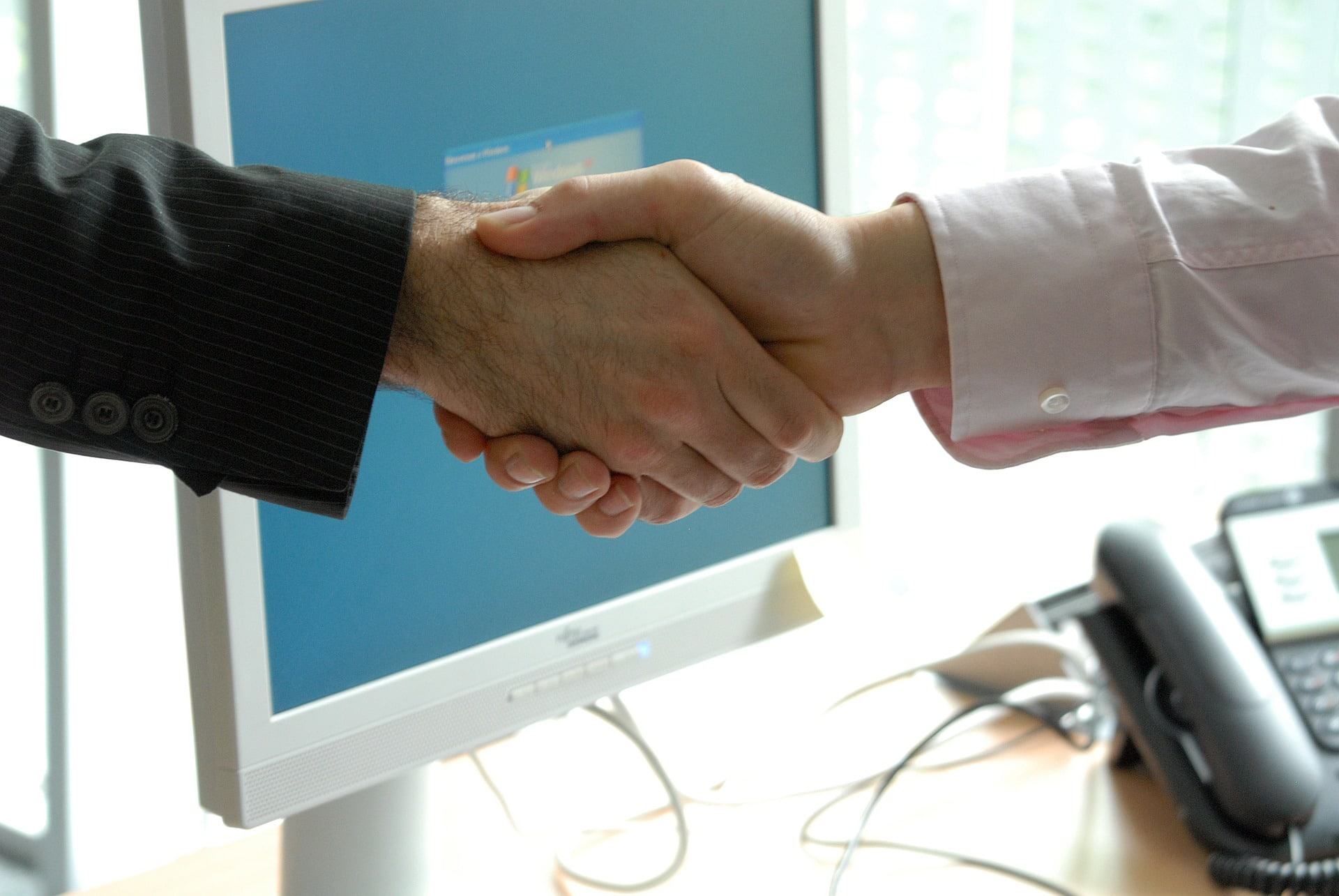 client and partner shaking hands